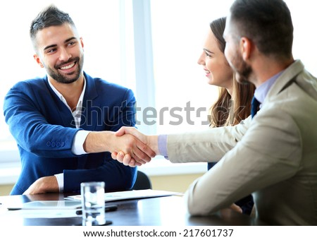 Business handshake. Handshake of two business men closing a deal at the office - stock photo