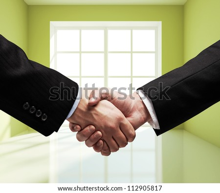 business handshake in green room - stock photo