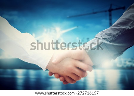 Business handshake in shipyard, shipbuilding company. Industry, deal, contract. - stock photo