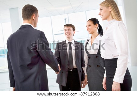 Business handshake of two successful partners at modern office - stock photo