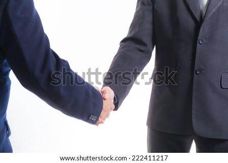 Business handshake on white backgroud - stock photo