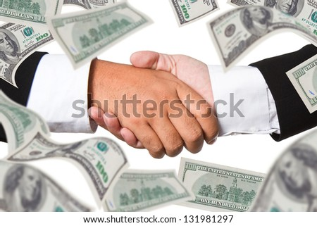 Business handshake with  money in background - stock photo