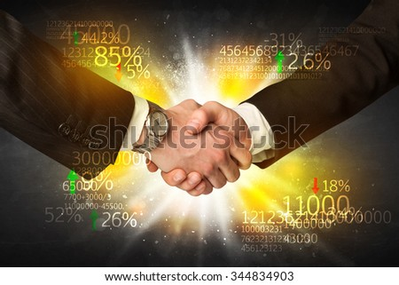 Business Handshake with number analysis - stock photo