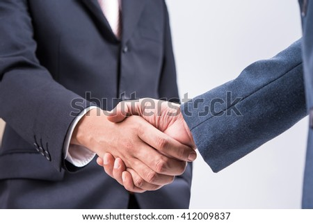 Business handshake with white background - stock photo