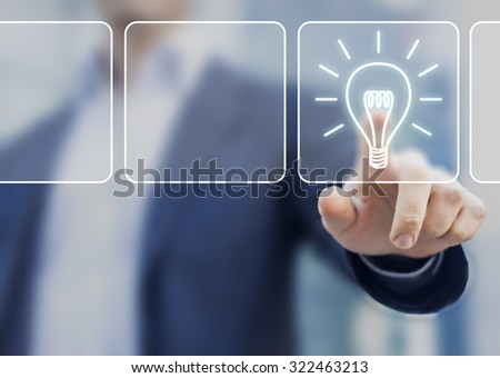 Business idea concept with lightbulb symbol touched by businessman and office background - stock photo