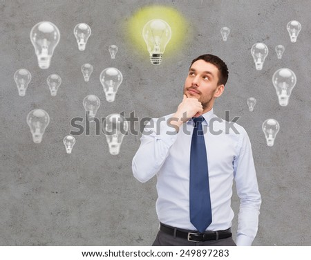 business, ideas, inspiration and people concept - handsome businessman looking up and thinking over concrete background with light bulbs - stock photo