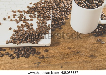 Business image and coffee cup and coffee beans - stock photo