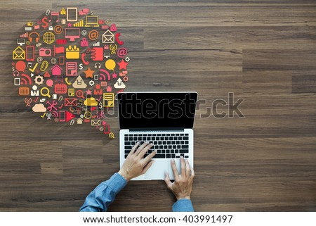 Business innovation technology set application icons, With businessman working on laptop computer PC on wood table, view from above - stock photo