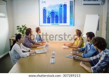 Business interface against attentive business team following a presentation - stock photo