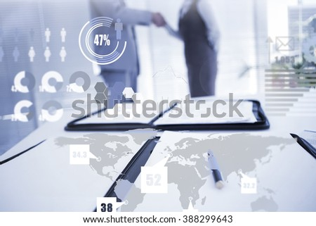 Business interface against business partners shaking hand together - stock photo