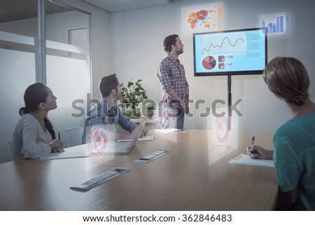 Business interface with graphs and data against attentive business team following a presentation - stock photo