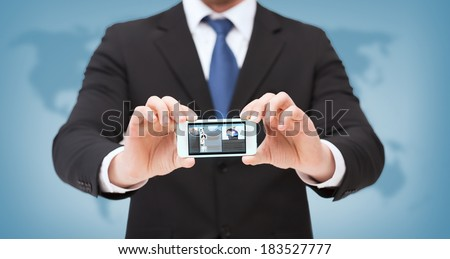 business, internet and technology concept - businessman showing smartphone with news on screen - stock photo