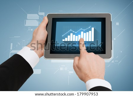 business, internet, economics and technology concept - close up of man hands touching tablet pc with increasing chart on screen - stock photo