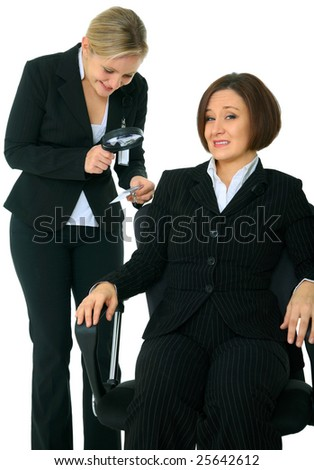 business investigator checking id tag of other businesswoman. concept for background check - stock photo