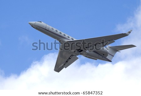 Business jet after take off - stock photo