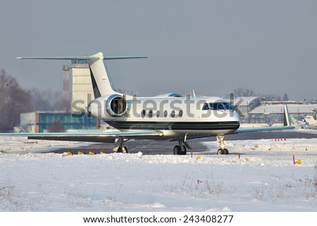 Business jet taxiing to the runway in winter - stock photo