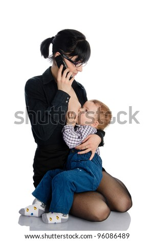 business lady breast feeding her little baby. isolated on white background - stock photo
