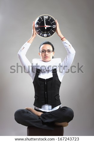 Business lady in ruff collar with a clock - stock photo