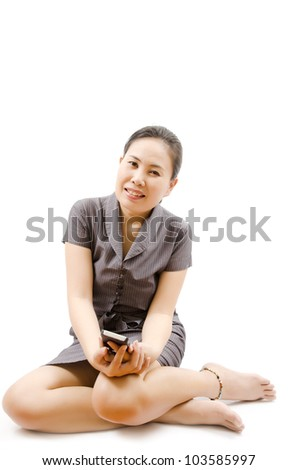 Business lady playing with mobile phone isolated. - stock photo