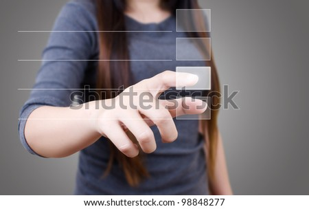 Business lady pushing correct choice on the whiteboard. - stock photo