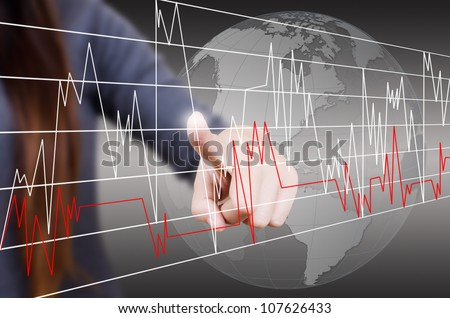 Business lady pushing finance graph for trade stock market on the whiteboard. - stock photo