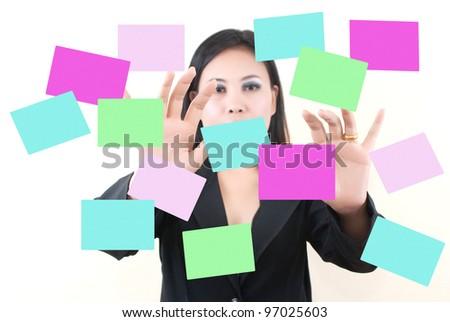 Business lady pushing on sticky note. - stock photo