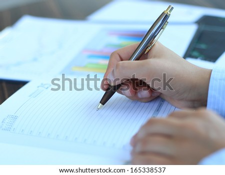 Business lady taking business notes at office - stock photo