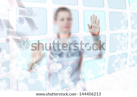 business lady touching button on the whiteboard,  bright scientific background - stock photo