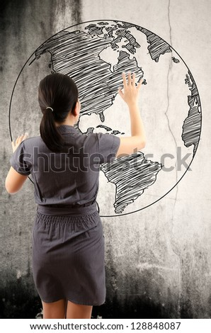Business Lady touching world map drawing on the wall. - stock photo
