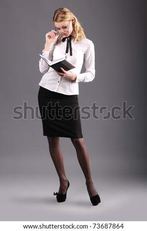 Business lady with glasses and literature - stock photo