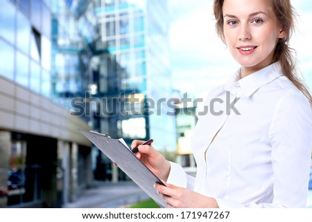 Business lady with positive look and cheerful smile. - stock photo