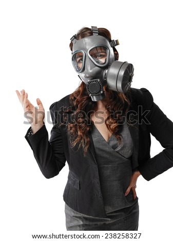 Business looking young adult woman wearing a personal gas mask and she introduce something - white background - stock photo