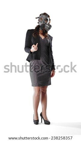 Business looking young adult woman wearing a personal gas mask and she raised her middle finger up - white background - stock photo