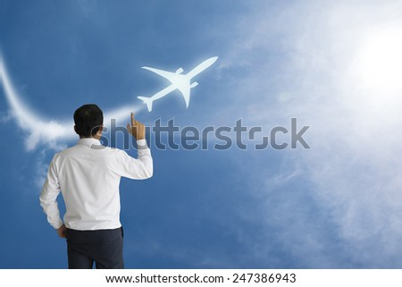 Business Male Hand drawing airplane - stock photo