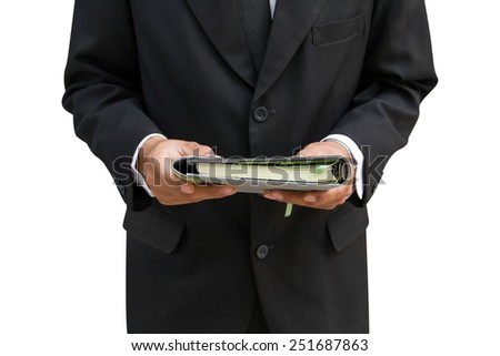 Business man and a book in hand - stock photo