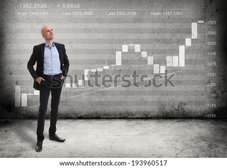Business man and a growing graph - stock photo