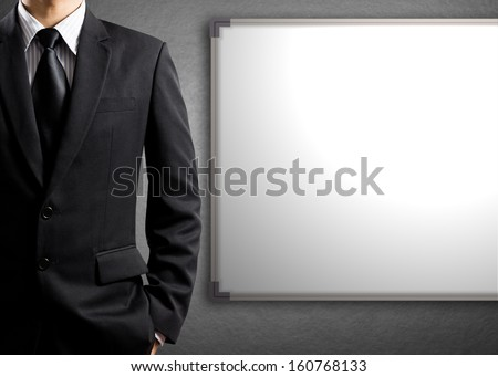 Business man and blank white board - stock photo