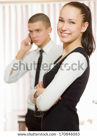 Business man and business woman in office - stock photo