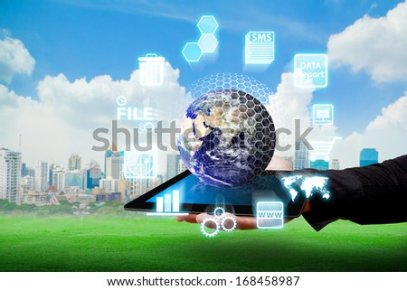 Business man and digital devices for working : Elements of this image furnished by NASA  - stock photo
