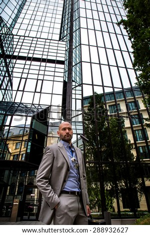 Business Man and Glass Building working place - stock photo