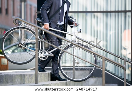 business man and his bicycle, concept bike go to work - stock photo