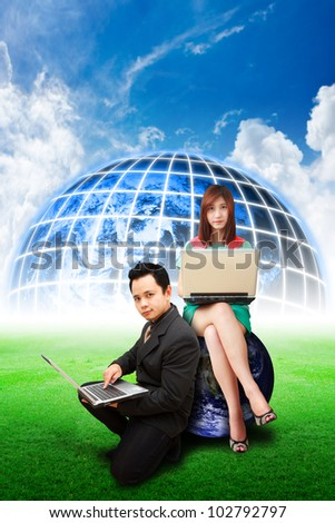 Business man and lady on globe on the grass field : Elements of this image furnished by NASA - stock photo