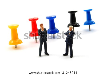 business man and push pin isolated on white background - stock photo