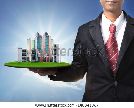 business man and real estate in hand use for property land management and  building construction theme - stock photo