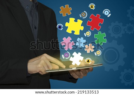 Business man and Success concept, Success word on puzzle piece. - stock photo