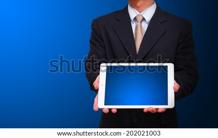 Business man and touch pad  - stock photo