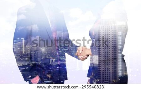 Business man and woman hand shake with multi exposure background - stock photo