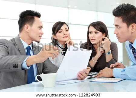 business man and woman meeting in the office discussing something - stock photo