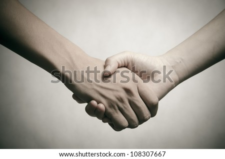 business man and woman shaking hands, isolated on white - stock photo