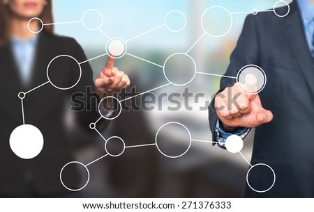 business man and women hand drawing blank flow chart on new modern computer as concept. Isolated on office. Stock Image - stock photo